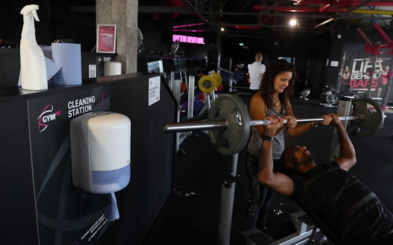 Radio DJ Ibe Sesay, with his wife Colleen, training at GymCo in Belfast, as gyms, cinemas and bingo halls are among the outlets reopening in Northern Ireland after the Stormont Executive agreed to ease lockdown measures - Brian Lawless/PA