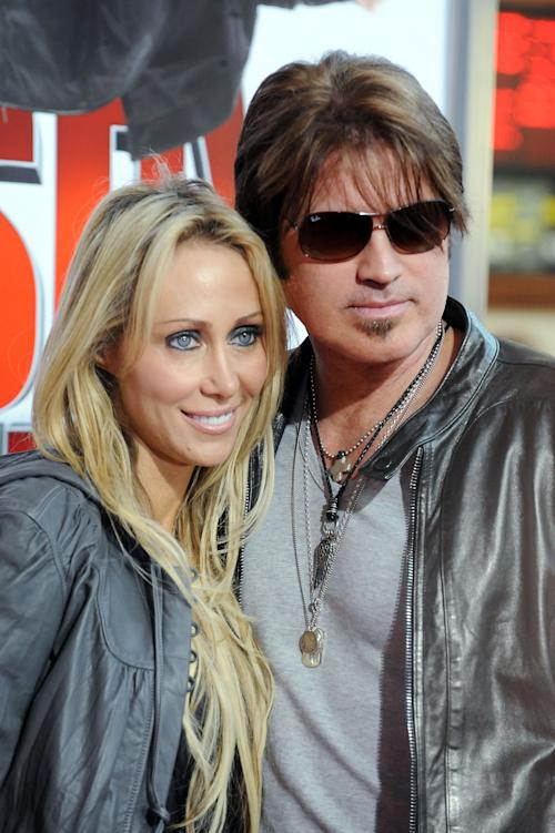 "FILE - In this Jan. 9, 2010 file photo, Billy Ray Cyrus, at right, and his wife Laeticia ""Tish"" Cyrus, arrive to the premiere of ""The Spy Next Door"" in Los Angeles. Court records show Tish Cyrus filed for divorce on Thursday, June 13, 2013 in Los Angeles Superior Court. (AP Photo/Katy Winn, file)"
