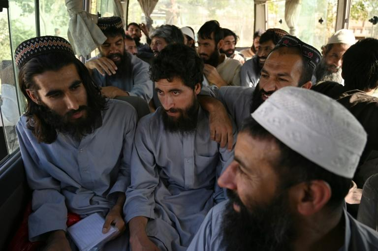 Taliban fighters sit in a vehicle after being released from the Bagram jail outside the Afghan capital Kabul