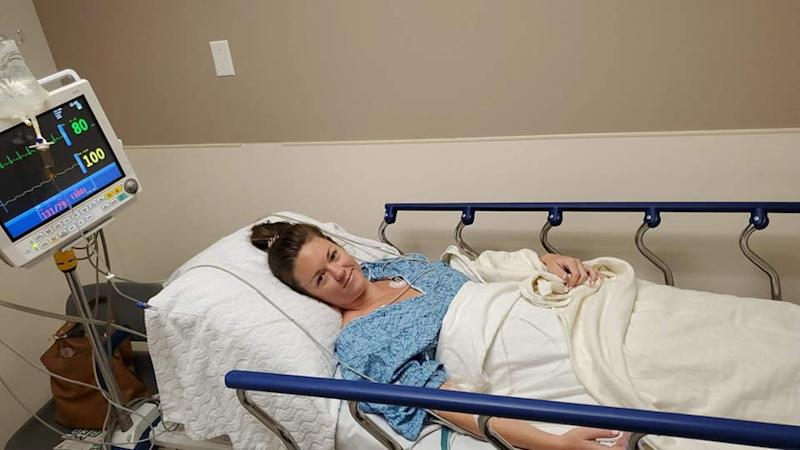 A photo of a woman in a hospital bed about to go into surgery to remove an engagement ring she swallowed while asleep.