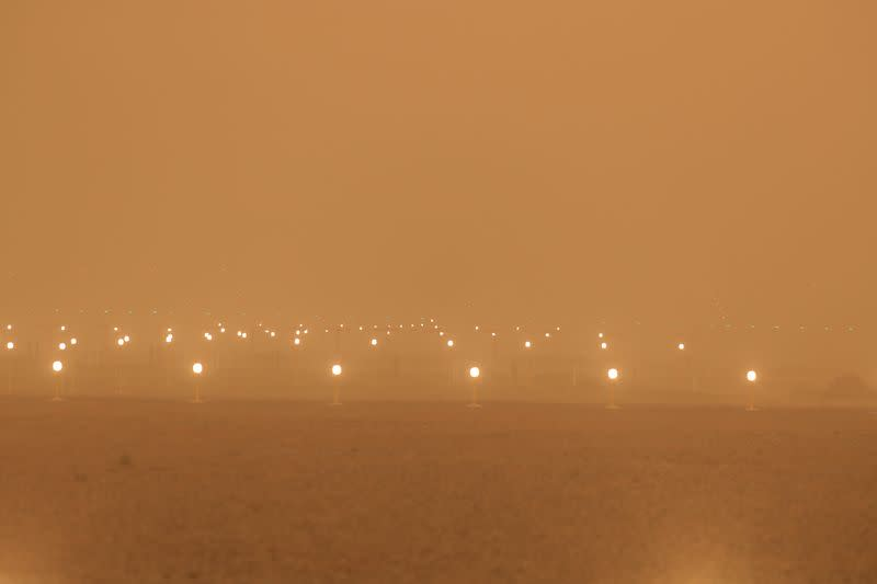 "A view of the runway during a sandstorm blown over from North Africa known as ""calima"" at Las Palmas Airport"