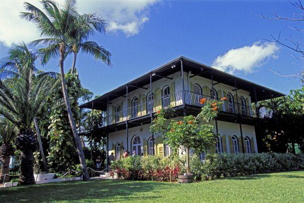 "<p>Built in 1851, this <a href=""https://www.hemingwayhome.com/general/"" target=""_blank"">Spanish Colonial</a> was a residence of Pulitzer Prize-winning author <a href=""https://www.countryliving.com/real-estate/a36595/famous-authors-homes/"" target=""_blank"">Ernest Hemingway</a> from 1931 until his death in 1961. While the house, which was added to the registry in 1968, has many of the writer's many hunting trophies on display, it is also home to a number of living creatures as well. Said to be descendants of a six-toed cat that belonged to Hemingway, a crew of 50-60 cats with an extra digit roam the property. The cats are given names by the museum staff and cared for by a veterinarian. </p>"