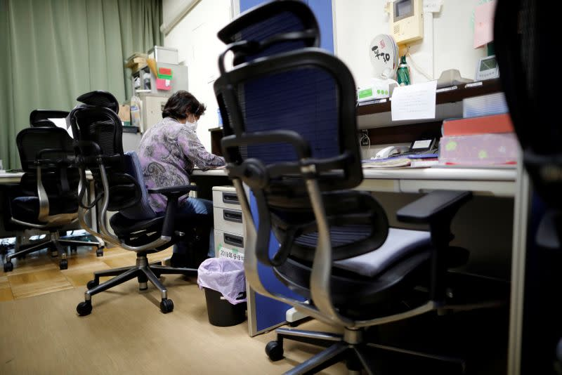 A volunteer handles an incoming call at the Tokyo Befrienders call center, a Tokyo's suicide hotline center, during the spread of the coronavirus disease (COVID-19), in Tokyo