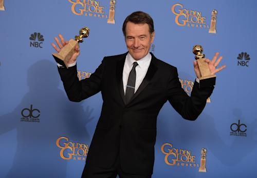 """Bryan Cranston poses in the press room with the award for best tv series - drama for """"Breaking Bad"""" and best actor in a tv series - drama for """"Breaking Bad"""" at the 71st annual Golden Globe Awards at the Beverly Hilton Hotel on Sunday, Jan. 12, 2014, in Beverly Hills, Calif. (Photo by Jordan Strauss/Invision/AP)"""