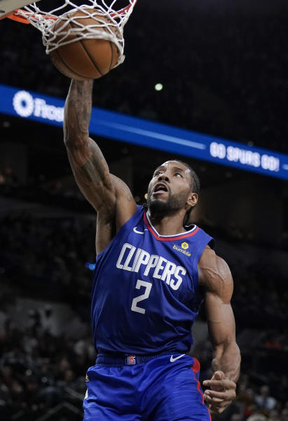 Los Angeles Clippers' Kawhi Leonard dunks during the first half of an NBA basketball game against the San Antonio Spurs, Saturday, Dec. 21, 2019, in San Antonio. (AP Photo/Darren Abate)
