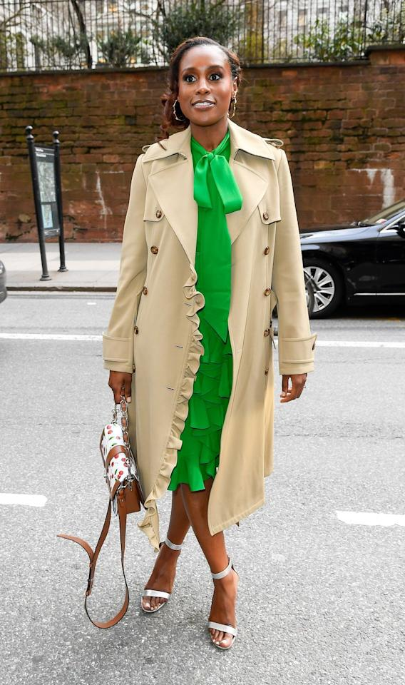 <p>Rae attended the Michael Kors show at New York Fashion Week in a pussy-bow dress with a ruffle skirt and handbag by the designer. </p>