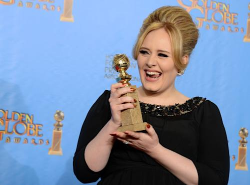 "Adele poses with the award for best original song in a motion picture for ""Skyfall"" backstage at the 70th Annual Golden Globe Awards at the Beverly Hilton Hotel on Sunday Jan. 13, 2013, in Beverly Hills, Calif. (Photo by Jordan Strauss/Invision/AP)"