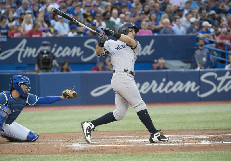 Aug 8, 2019; Toronto, Ontario, CAN; New York Yankees center fielder Mike Tauchman (39) hits a two run home run during the third inning against the Toronto Blue Jays at Rogers Centre. Mandatory Credit: Nick Turchiaro-USA TODAY Sports