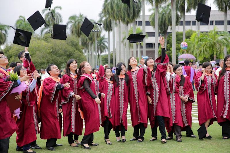 UPM graduates pose for pictures after their graduation ceremony at UPM's 38th Convocation Ceremony, November 1, 2014. UPM's latest results are a continuation of its recent improvements that saw it take 33rd in the QS University Rankings Asia last year. — File picture by Choo Choy May
