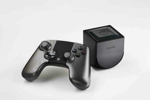 This photo provided by Ouya shows an Ouya, the Android-based video game console that aims to challenge the dominance of the Xboxes, Nintendos and PlayStations of the world. The console goes on sale Tuesday, June 25, 2013. (AP Photo/Ouya)