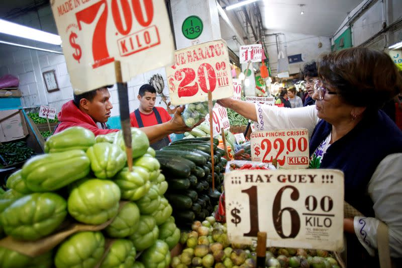 FILE PHOTO: A woman reaches for a bag of produce in the Central de Abastos wholesale market in Mexico City