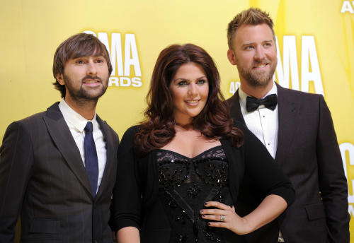 FILE - This Nov. 1, 2012 file photo shows members of the band Lady Antebellum, from left, Dave Haywood, Hillary Scott and Charles Kelley at the 46th Annual Country Music Awards at the Bridgestone Arena in Nashville, Tenn. The trio won the breakthrough award at the 2012 Billboard Touring Awards on Thursday, Nov. 8, 2012, in New York, for the success it had on its million-selling Own the Night world tour. (Photo by Chris Pizzello/Invision/AP, File)