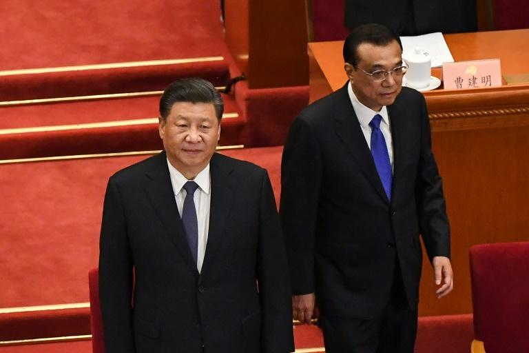 Chinese President Xi Jinping (L) and Premier Li Keqiang (R) arrive for the opening session of the Chinese People's Political Consultative Conference