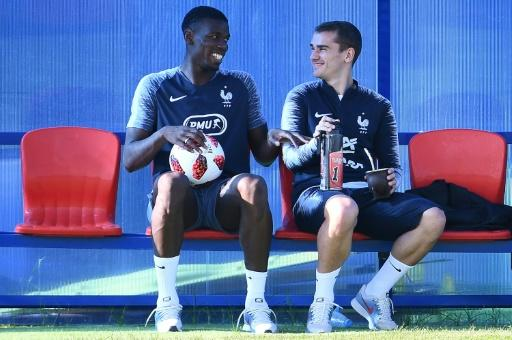 Paul Pogba and Antoine Griezmann share a joke in training ahead of the World Cup final