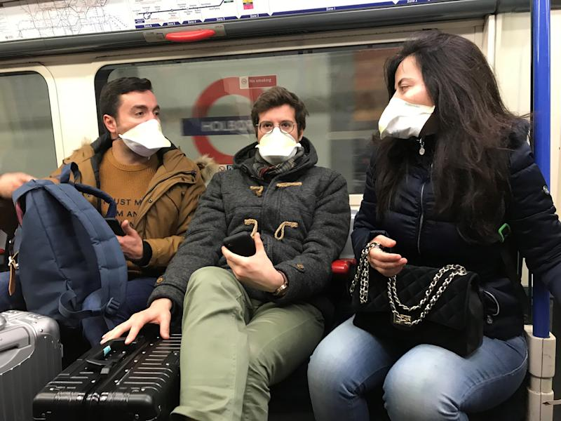 People wearing face masks on the London Underground, as the first case of coronavirus has been confirmed in Wales and two more were identified in England - bringing the total number in the UK to 19. (Photo by Kirsty O'Connor/PA Images via Getty Images)
