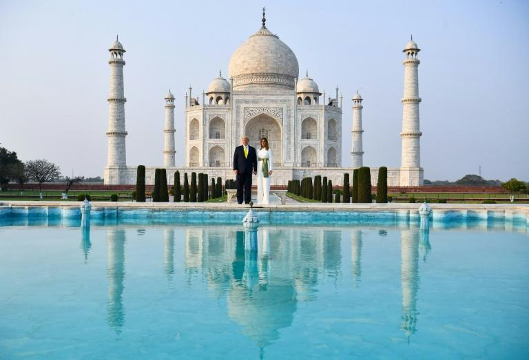 """US President Donald Trump and First Lady Melania Trump pose at India's Taj Mahal, a marble monument that UNESCO calls a """"jewel of Muslim art"""""""