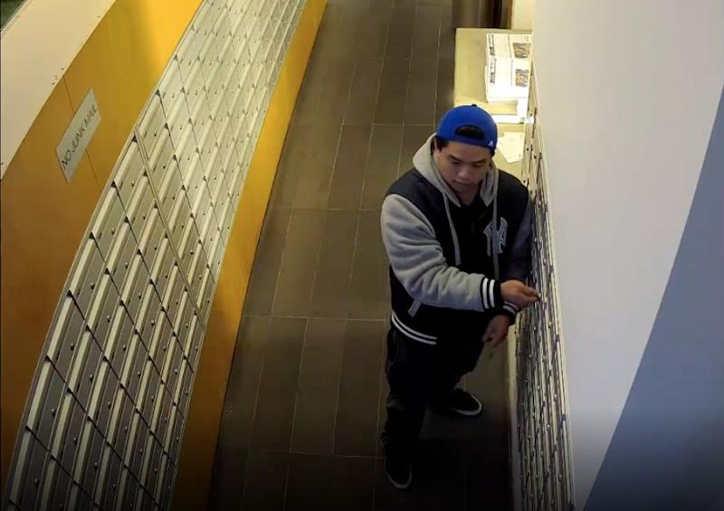 The man was wearing a blue baseball cap and New York Yankees bomber jacket during one of the alleged incidents at the Melbourne apartment block.