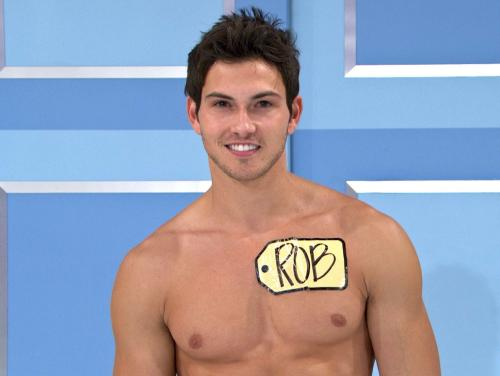 "This undated image from video shows Rob Wilson, of Boston, who was chosen in an online competition to be the first male model on the popular daytime game show, ""The Price is Right."" Wilson begins his week-long stint alongside the ladies on Oct. 15. Hosted by Drew Carey, ""The Price Is Right"" airs weekdays at 11 a.m. Eastern time. (AP Photo/CBS)"