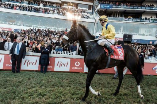 "Winning jockey Anton Marcus and his horse ""Do it Again"""