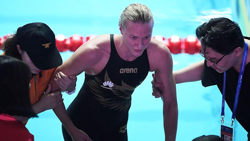 Sarah Sjostrom was helped away from the pool as she sought medical assistance. Pic: Getty