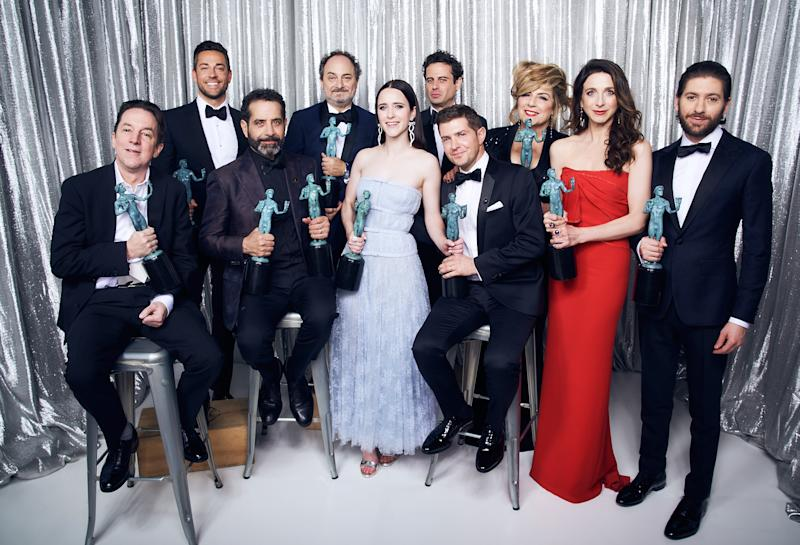 A photo of Joel Johnstone, Caroline Aaron, Michael Zegen, Marin Hinkle, Kevin Pollak, Rachel Brosnahan, Luke Kirby, Brian Tarantina, Tony Shalhoub, and Zachary Levi, winner of Outstanding Performance by an Ensemble in a Comedy Series for 'The Marvelous Mrs. Maisel,' pose in the Winner's Gallery during the 25th Annual Screen Actors Guild Awards at The Shrine Auditorium on January 27, 2019 in Los Angeles, California.