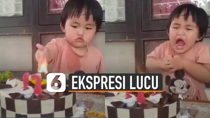 VIDEO: Lucu, Ekspresi Bocah Mencoba Panasnya Lilin Kue Ulang Tahun