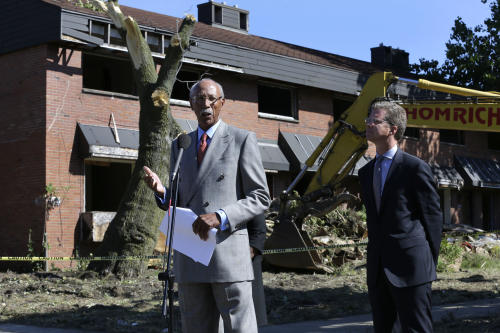 Detroit Mayor Dave Bing, left, speaks while United States Department of Housing and Urban Development Secretary Shaun Donovan listens at the first stage of demolishing the Frederick Douglass Homes in Detroit, Wednesday, Sept. 4, 2013. The graffiti-covered complex comprising several city blocks is better known as the Brewster projects. A $6.5 million emergency federal grant covers the initial phase of demolition and cleanup, and officials say the city will be eligible for more money when that's completed. The federal money comes at a crucial time for the city, which is overseen by a state-appointed emergency manager and in July became the nation's largest city to file for bankruptcy. (AP Photo/Paul Sancya)