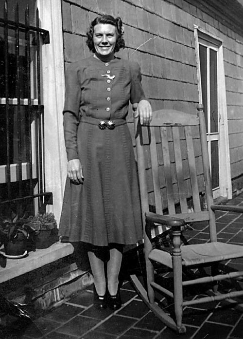 """This circa 1940s photo provided by The Preservation Society of Newport County shows maid Nellie Lynch on the roof outside the servants' quarters of The Elms mansion in Newport, R.I. Newly discovered photographs, documents and family histories have inspired the creation of a tour about servants at The Elms, echoing themes of the British drama program, """"Downton Abbey."""" (AP Photo/The Preservation Society of Newport County)"""
