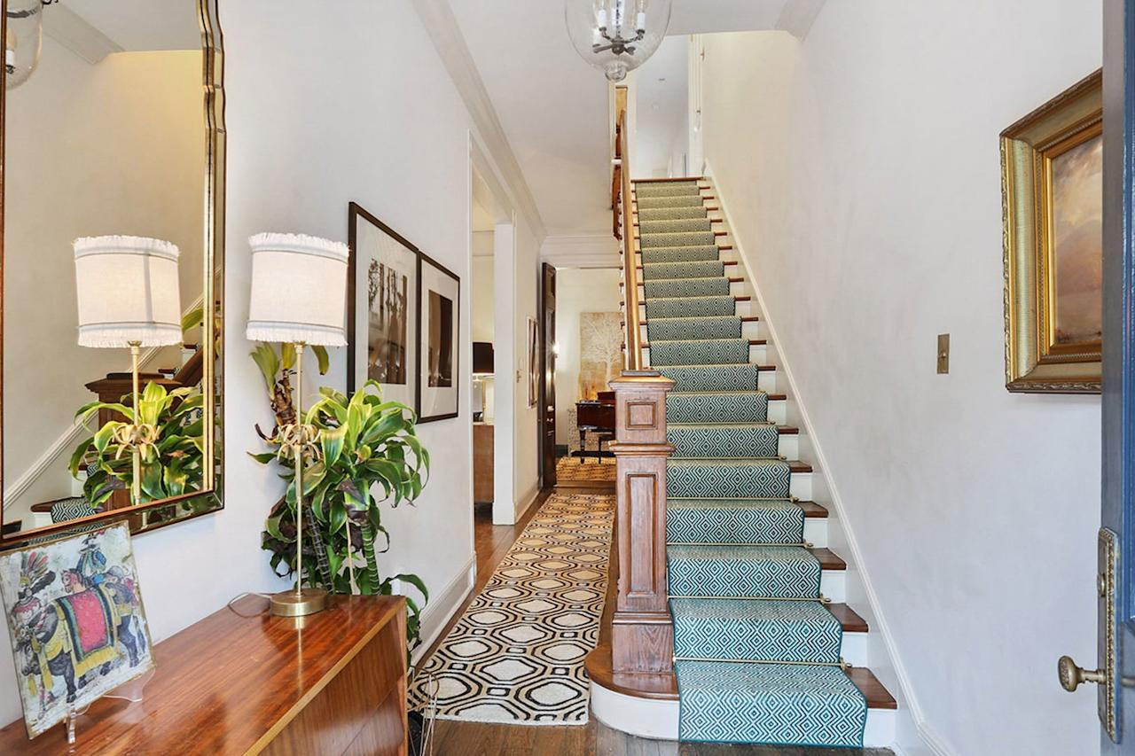 <p>The original stairwell scrollwork has been restored and repainted to period specifications.</p>