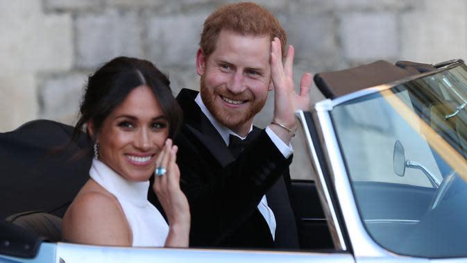 Meghan Markle dan Pangeran Harry. (STEVE PARSONS / POOL / AFP)