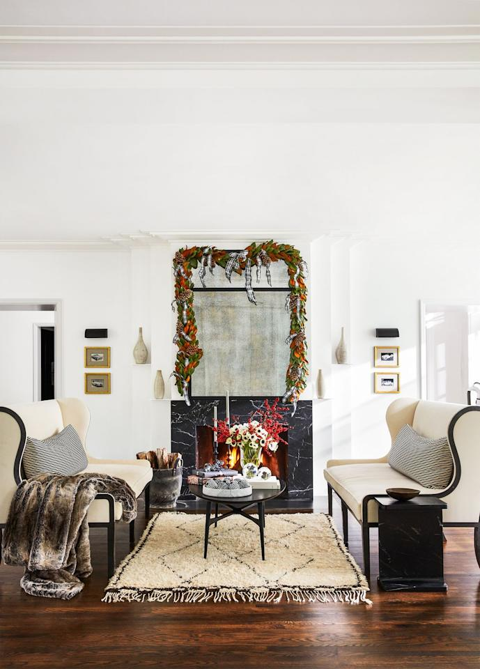 """<p>A simple harvest garland adorned with plaid ribbons gets this contemporary living room in the home of CB2 president Ryan Turf ready for a stylish holiday season.</p><p><a class=""""body-btn-link"""" href=""""https://go.redirectingat.com?id=74968X1596630&url=https%3A%2F%2Fwww.ballarddesigns.com%2Fbd%2F544136&sref=https%3A%2F%2Fwww.housebeautiful.com%2Fentertaining%2Fholidays-celebrations%2Fg3957%2Fchristmas-garlands%2F"""" target=""""_blank"""">BUY NOW</a> <strong><em>Suzanne Kasler Plaid Ribbon, $39</em></strong></p>"""