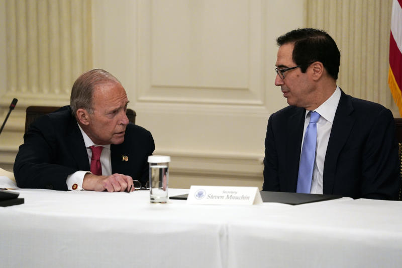 FILE - In this May 8, 2020, file photo Treasury Secretary Steven Mnuchin, right, talks with White House chief economic adviser Larry Kudlow prior to a meeting between President Donald Trump and Republican lawmakers in the State Dining Room of the White House in Washington. Some of Trump's top economic advisers emphasized on Sunday, May 10, the importance of states getting more businesses and offices open. (AP Photo/Evan Vucci, File)