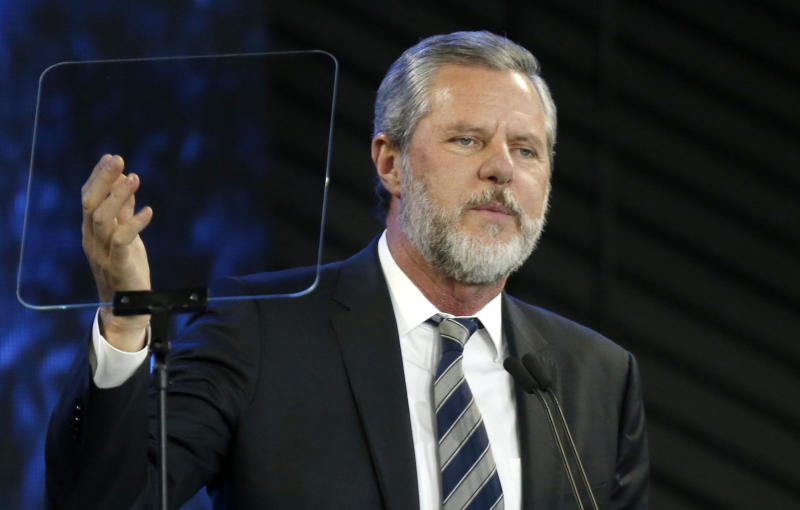 FILE - In this Nov. 28, 2018, file photo, Jerry Falwell Jr. speaks before a convocation at Liberty University in Lynchburg, Va. The university, led by Falwell, is pushing for criminal trespassing charges to be lodged against two journalists who pursued stories about why the evangelical college has remained partially open during the coronavirus outbreak. (AP Photo/Steve Helber, File)