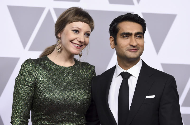 """FILE - This Feb. 5, 2018 file photo shows Emily V. Gordon, left, and Kumail Nanjiani at the 90th Academy Awards Nominees Luncheon in Beverly Hills, Calif. Nanjiani has a name for the COV19-era. He calls it """"The Weirds."""" He and his wife have been documenting their lockdown experience – the mood swings and anxieties -- in a podcast called """"Staying In,"""" for charity. (Photo by Jordan Strauss/Invision/AP, File)"""