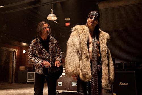"This film image released by Warner Bros. Pictures shows Alec Baldwin as Dennis Dupree, left, and Tom Cruise as Stacee Jaxx in New Line Cinema's rock musical ""Rock of Ages,"" a Warner Bros. Pictures release. (AP Photo/Warner Bros. Pictures, David James)"