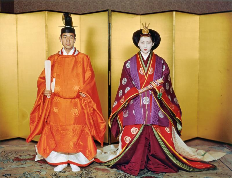 This April 10, 1959 picture shows Japan's Emperor Akihito (L) and Empress Michiko (R) posing for their wedding at the Kashiko Dokoro in Imperial Palace in Tokyo. (Photo by JIJI PRESS / Imperial Household Agency / AFP) / Japan OUT (Photo credit should read JIJI PRESS/AFP/Getty Images)