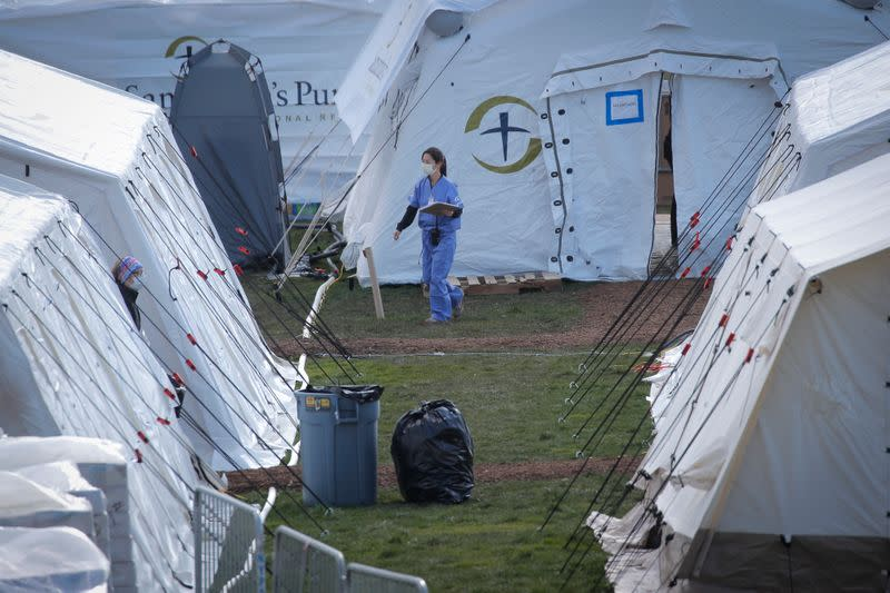 Healthcare worker outside newly constructed field hospital in East Meadow of Central Park during outbreak of coronavirus disease (COVID-19) in New York