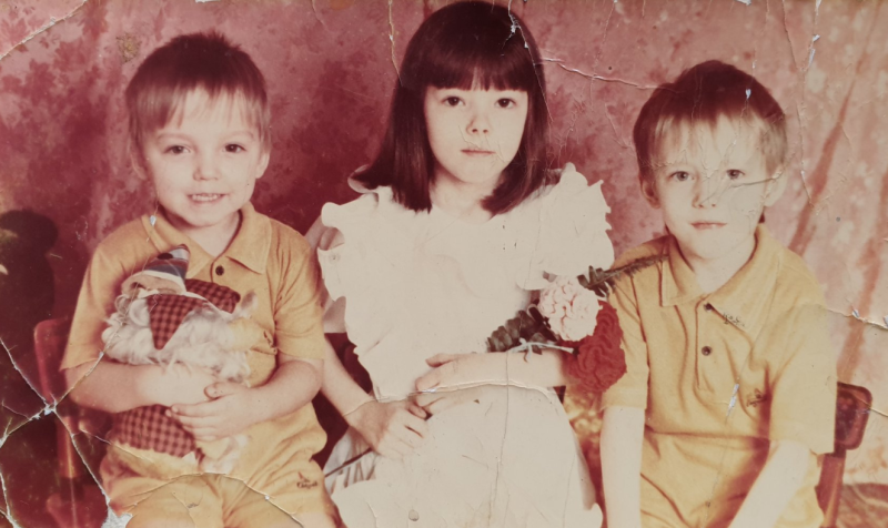 Photo of the three siblings together as young children without Maxim, who was separated from the family in 2002.