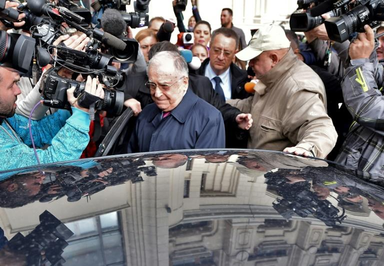 Ion Iliescu (C) is accused of 'contributing to the institution of a generalised psychosis'