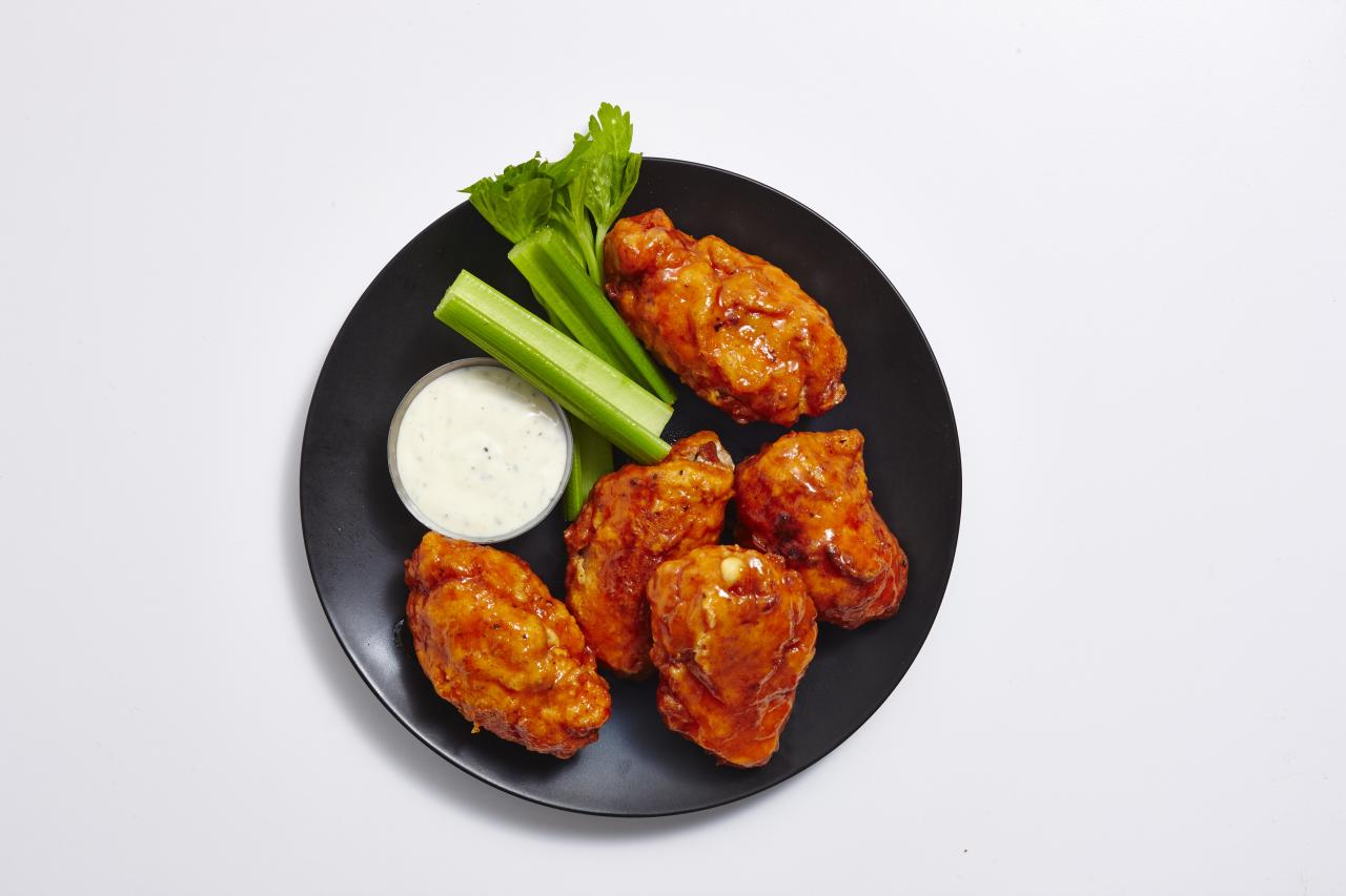 """<p>We don't use the word """"ultimate"""" lightly when we say, the time has come for the <b>ultimate buffalo chicken experience</b>. Using chicken breasts, we've created boneless chicken """"wings,"""" which are stuffed with mozzarella and blue cheese, fried, and tossed in a finger-licking-good buffalo sauce before being served with your choice of ranch or blue cheese dressing. Talk about the perfect party food…</p> <p><a href=""""https://www.myrecipes.com/recipe/boneless-stuffed-buffalo-wings"""">Boneless Stuffed Buffalo Wings Recipe</a></p>"""