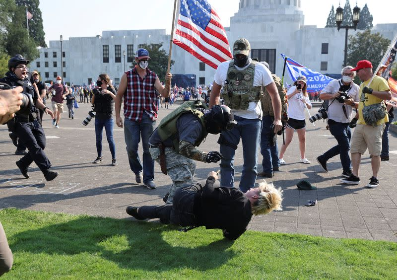 Police break up scuffles between demonstrators, arrest two in Oregon's state capital