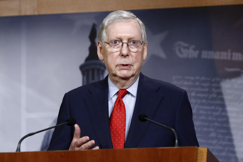 FILE - In this April 21, 2020, file photo Senate Majority Leader Mitch McConnell of Ky., speaks with reporters after the Senate approved a nearly $500 billion coronavirus aid bill on Capitol Hill in Washington. House Speaker Nancy Pelosi shelved a proposal for proxy voting this week after Republicans objected. In the Senate, McConnell rejected a GOP remote vote proposal. He expects Congress to return May 4, as planned. (AP Photo/Patrick Semansky, File)