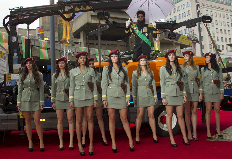 British actor Sacha Baron Cohen, top right, who plays Admiral General Aladeen, arrives for the World Premiere of 'The Dictator', at a cinema in Soutbank in central London, Thursday, May 10, 2012. (AP Photo/Joel Ryan)