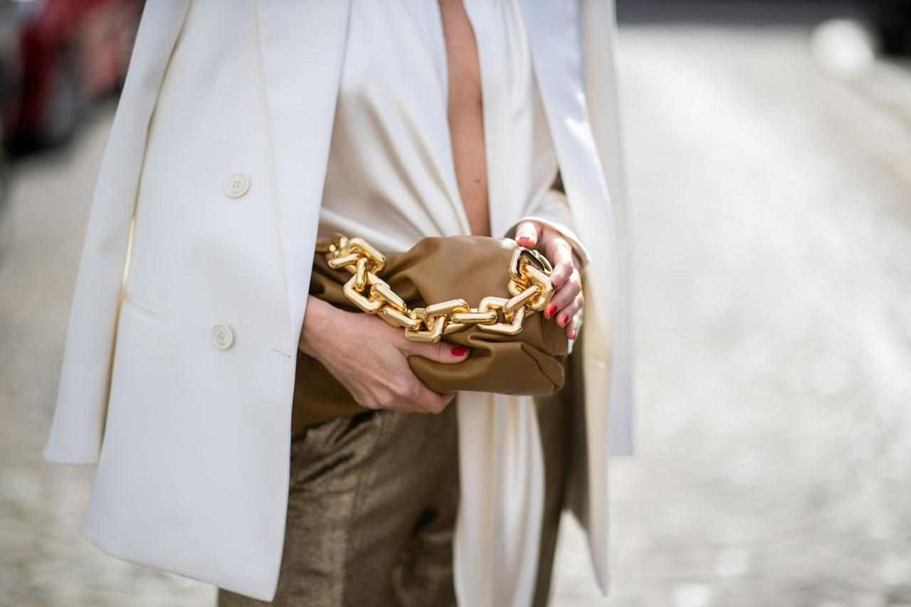 <p>Current trends have been orbiting around the chunky gold chain, and for good reason. The '90s staple has been hanging around our necks all year, and now, thanks to Bottega Veneta, it's adorning our bags as well.</p>