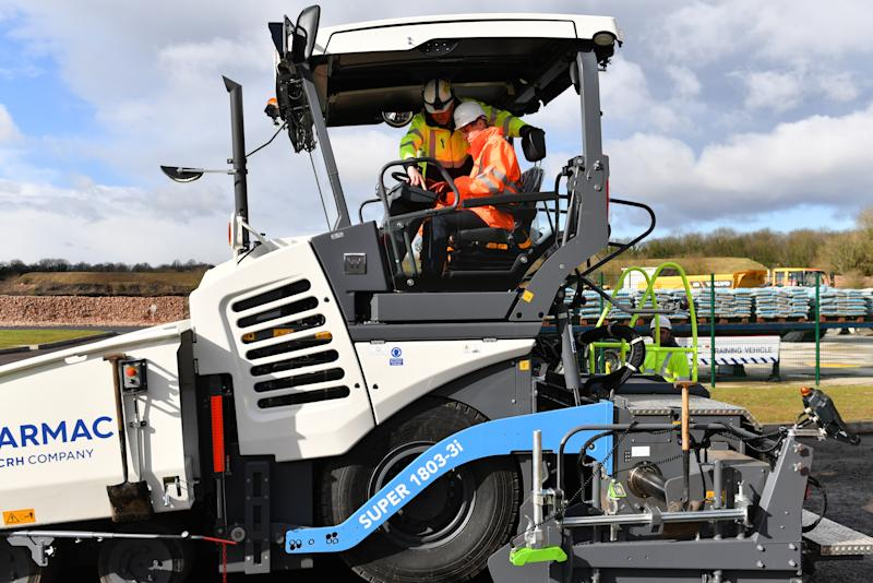 The Duke of Cambridge (left) operating an asphalt paver during a visit to the Tarmac National Skills and Safety Park in Nottinghamshire.