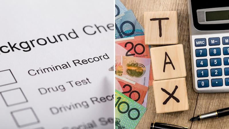A background check application form and a desktop with Australian money, three cubes spelling tax and calculator.