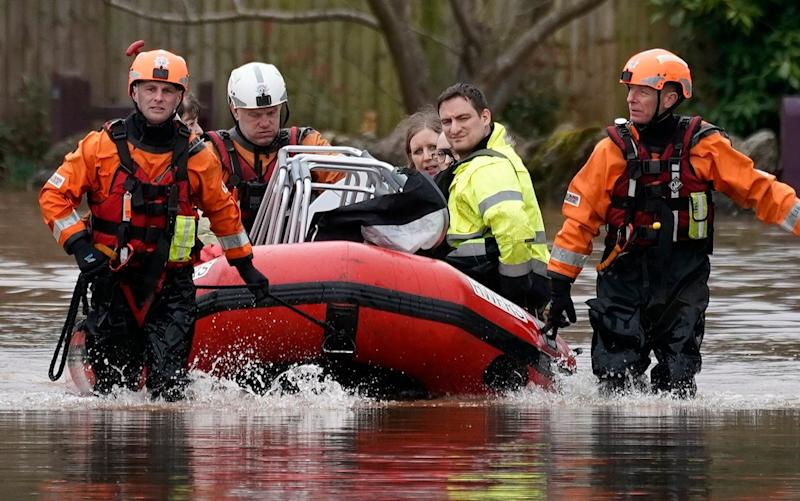 Firefighters played a major part in the flooding which hit parts of the UK in the winter - Getty Images