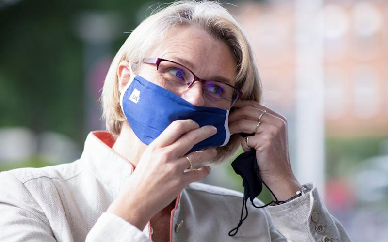 Anja Karliczek, German minister for Education and Research puts on a face mask during her visit to the Hamburg-Eppendorf university clinic - Pool/Reuters