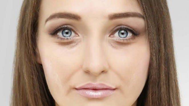 ilustrasi wanita yang memiliki kantung mata hitam.