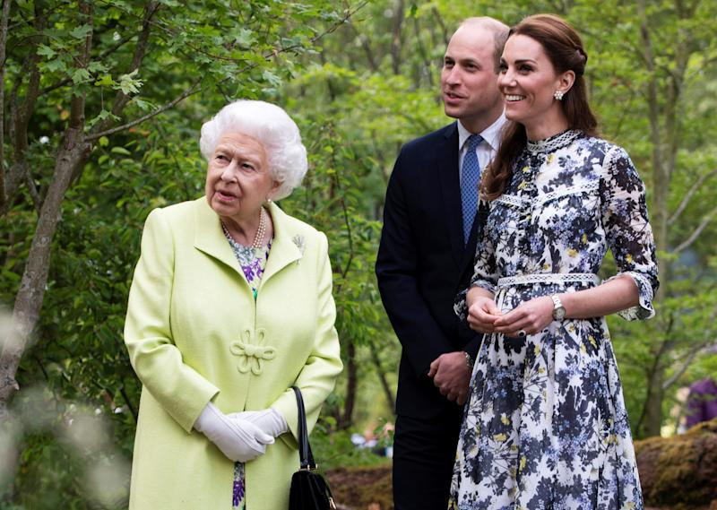 TOPSHOT - Britain's Catherine, Duchess of Cambridge (R) shows Britain's Queen Elizabeth II (L) and Britain's Prince William, Duke of Cambridge, around the 'Back to Nature Garden' garden, that she designed along with Andree Davies and Adam White, during their visit to the 2019 RHS Chelsea Flower Show in London on May 20, 2019. - The Chelsea flower show is held annually in the grounds of the Royal Hospital Chelsea. (Photo by Geoff Pugh / POOL / AFP) (Photo credit should read GEOFF PUGH/AFP/Getty Images)